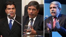 Jorge Capitanich, Juan Manuel Abal Medina y Aníbal Fernández, los tres ex jefes de Gabinete señalados en la causa por el Fútbol para Todos.