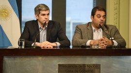 Marcos Peña y Jorge Triaca en conferencia de prensa